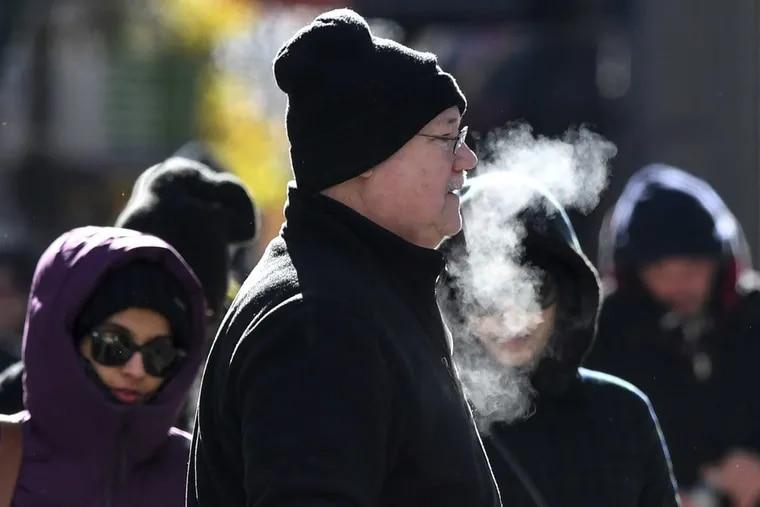 Pedestrians along Chestnut St. at 16th brave the freezing temperatures in Center City Philadelphia on Thursday, December 28, 2017.
