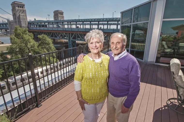 Seymour Kurland and his wife, Shirley, standing on the the deck of their penthouse in Old City in 2015.