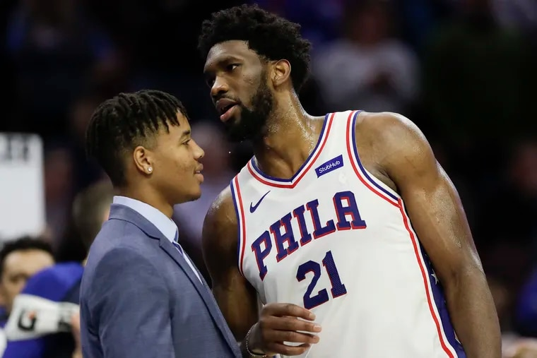 Markelle Fultz (left) has been in Los Angeles doing physical therapy to address thoracic outlet syndrome. He has not played for the 76ers since Nov. 21.