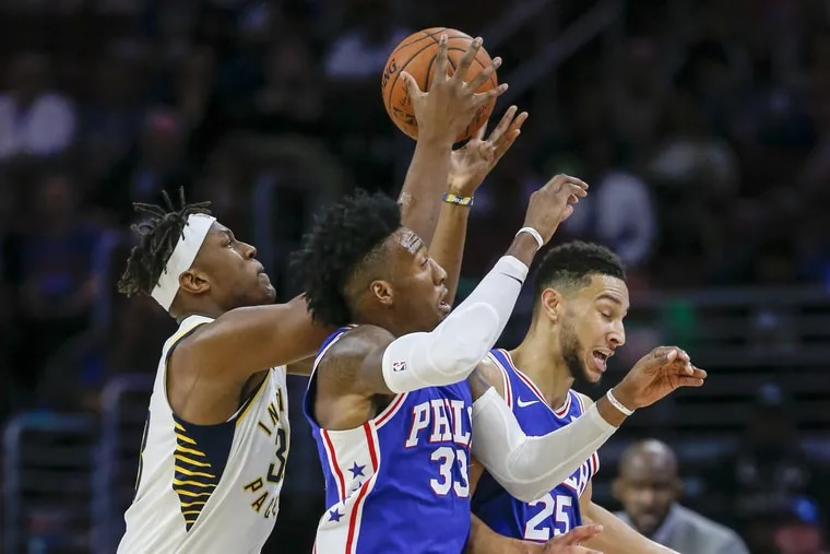 Sixers guard Ben Simmons (right) and forward Robert Covington go after the basketball against Indiana Pacers center Myles Turner during the third-quarter on Friday, November 3, 2017 in Philadelphia.