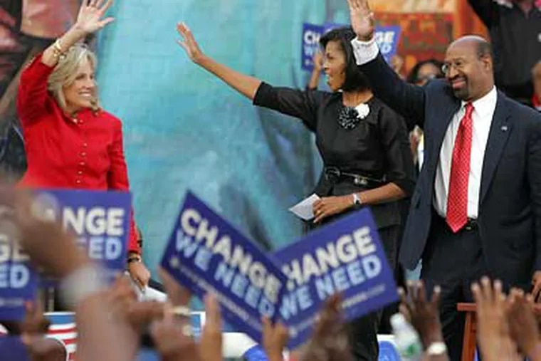 Jill Biden, Michelle Obama and Mayor Michael Nutter wave to the crowd as they come on stage at the beginning of a rally at Francis J. Myers Recreation Center in Southwest Philadelphia on Wednesday. (Barbara L. Johnston/Inquirer)