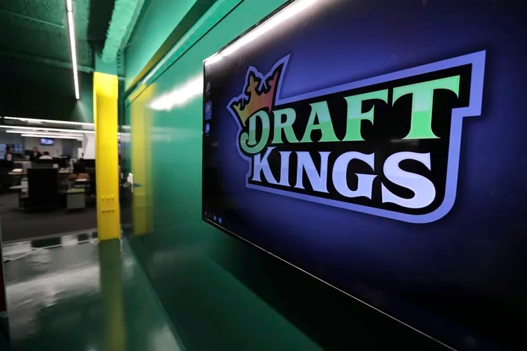 In this May 2, 2019, file photo, the DraftKings logo is displayed at the sports betting company headquarters in Boston.