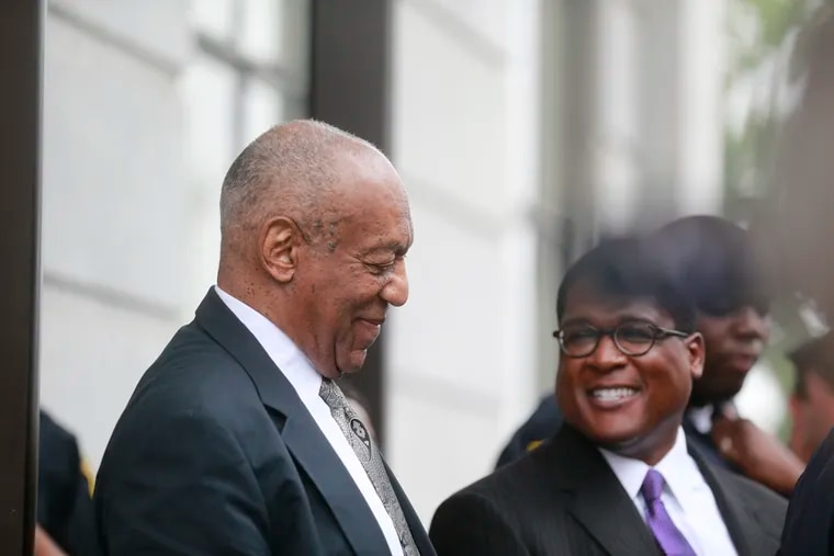 Bill Cosby leaves Montgomery County Courthouse with his spokesman Andrew Wyatt for the sixth day of deliberation after a mistrial was declared Saturday June 17th, 2017.