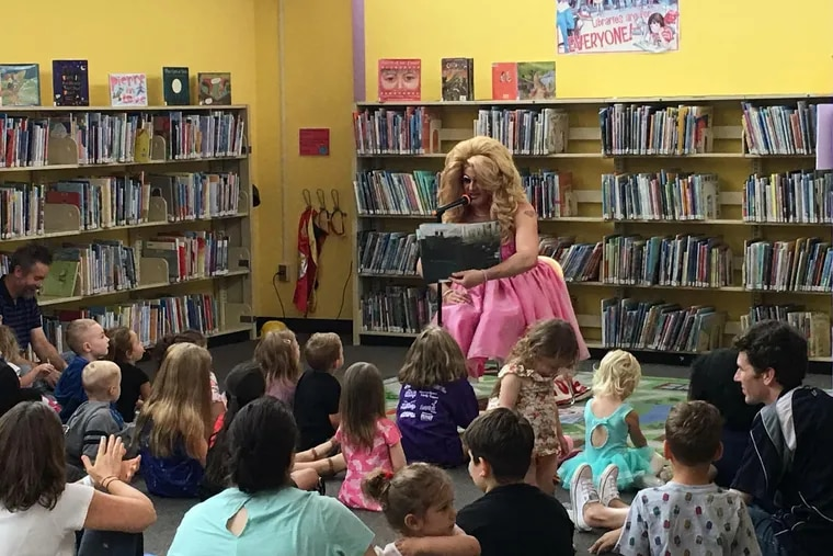 Brittany Lynn reads to children during a Drag Queen Story Hour