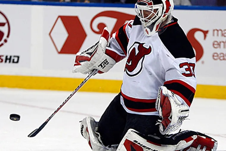 New Jersey Devils goalie Martin Brodeur stops a shot against the Buffalo Sabres.  Tonight, he will face the Flyers. (AP Photo/ David Duprey)