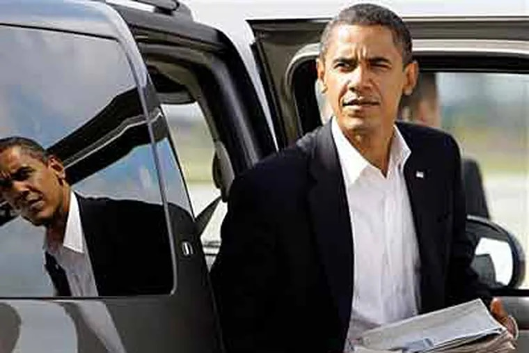 Democratic presidential candidate Sen. Barack Obama, D-Ill., steps out of the car on the tarmac before he boards his campaign plane at the airport in Indianapolis, Ind., on  Wednesday. (AP Photo/Alex Brandon)