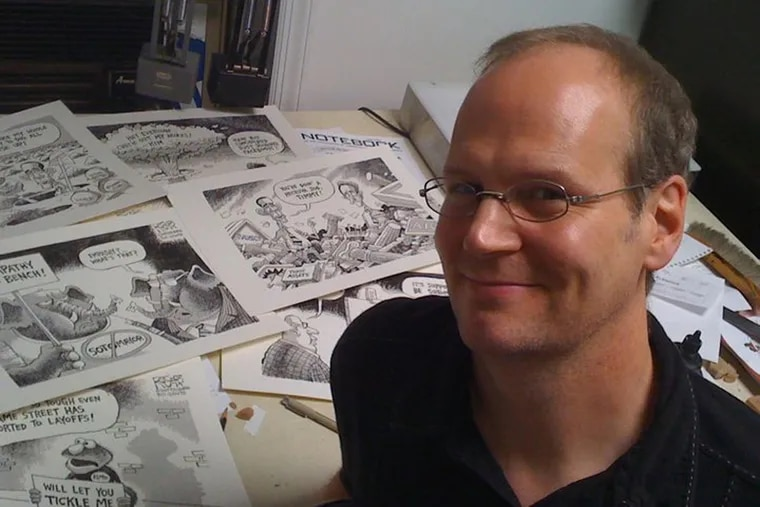 Pittsburgh Post-Gazette editorial cartoonist Rob Rogers at his drawing desk. Rogers has had the last week's worth of cartoons killed by his editor, an unusual occurrence in the world of editorial cartooning.