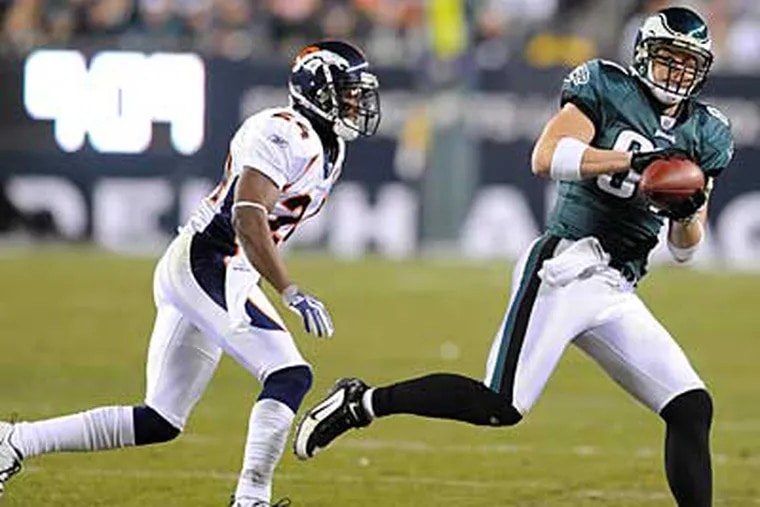Brent Celek hauls in a pass in front of Broncos cornerback Champ Bailey and runs for a 34-yard gain. ( Clem Murray / Staff Photographer )