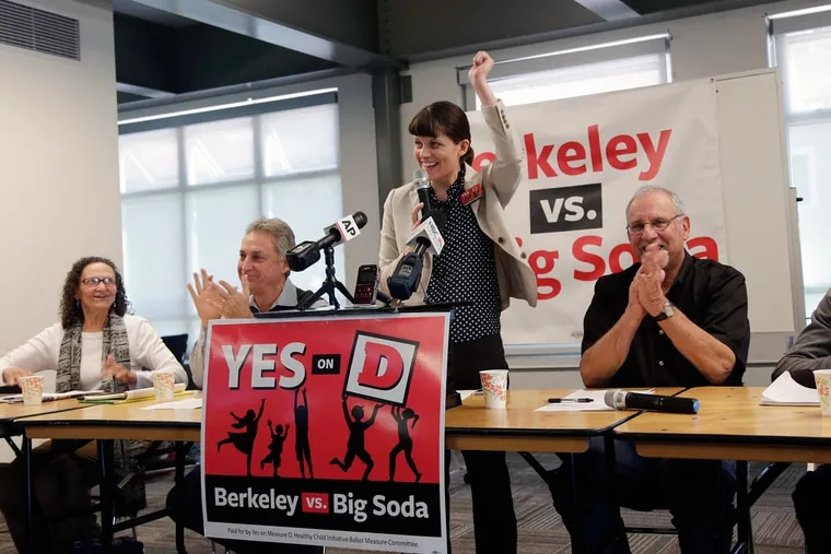 Campaign manager Sara Soka (center) celebrated with fellow supporters after a soda tax was passed in California in 2014 to raise money for schools, parks.