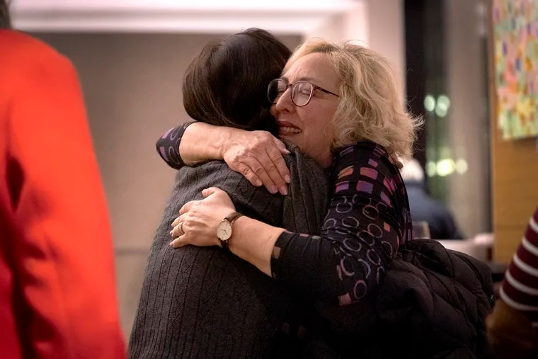 Lisa Steinberg, the Director of Leadership Engagement at the Auschwitz-Birkenau Memorial Foundation, gives a goodbye hug to a guest at a farewell dinner for Holocaust survivors at the QPlus Hotel in Krakow, Poland on January 28, 2020. Steinberg helped to organize and lead the travel of over 100 Auschwitz-Birkenau survivors and their families as they returned to Poland to mark the 75th anniversary of the liberation of Auschwitz.