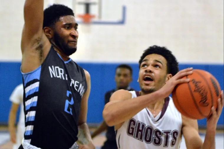 Abington's Robbie Heath, right, drives for a basket in a game last season against North Penn.