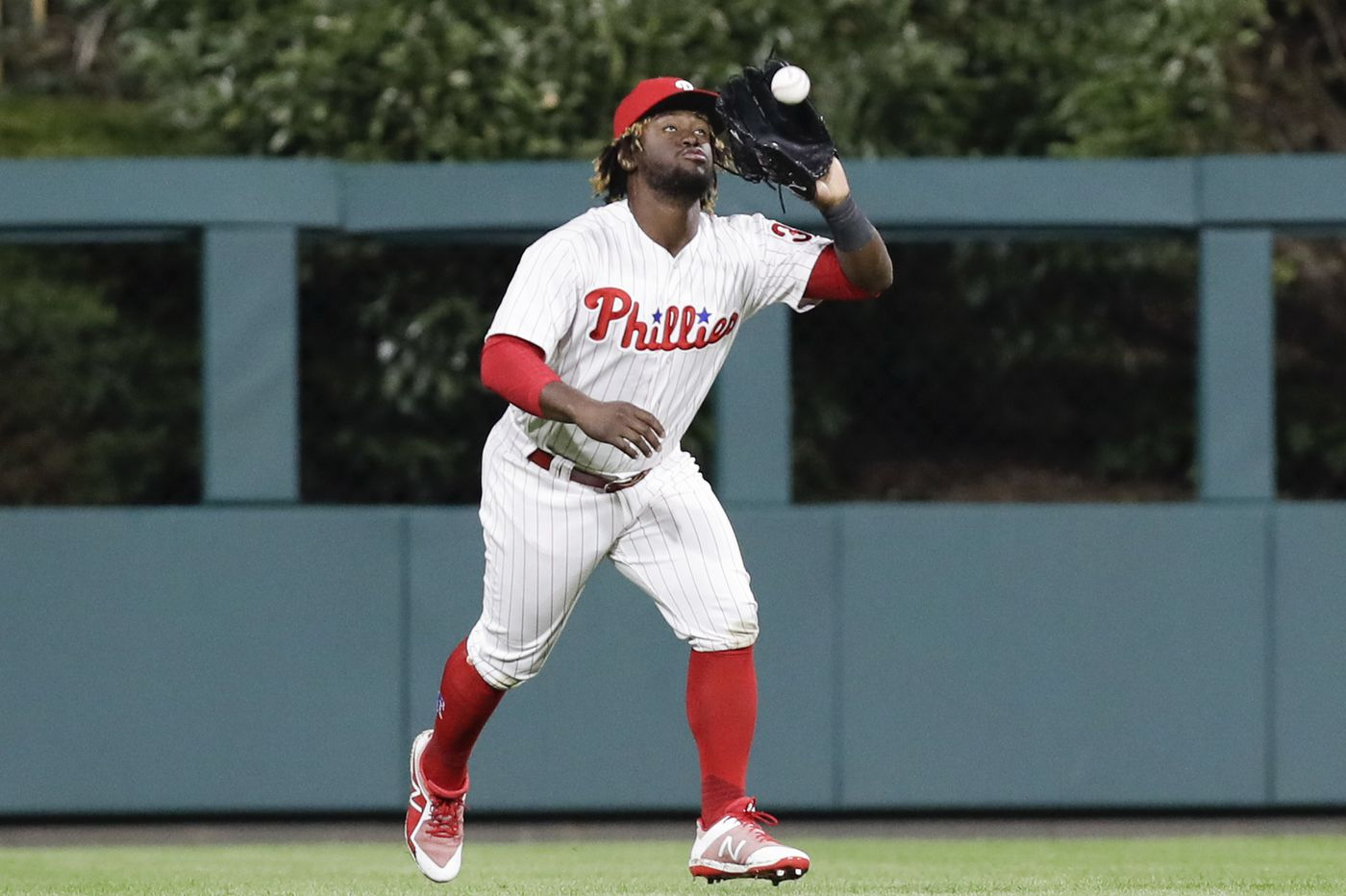 If the Phillies sign Bryce Harper, what happens to the rest of the outfield?