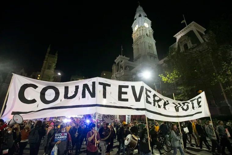 Protesters gather on Nov. 4, 2020, at City Hall. The banner urges the counting of every vote.