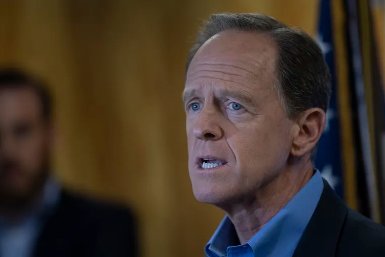 Sen. Pat Toomey (R., Pa.) speaks at the podium during a press conference at the U.S. Customs House on Tuesday, Aug. 6, 2019, in Philadelphia.