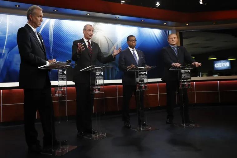 Candidates, from left, Assemblyman John Wisniewski, Phil Murphy, Jim Johnson and Sen. Ray Lesniak attend a Democratic gubernatorial primary debate in Newark, N.J.