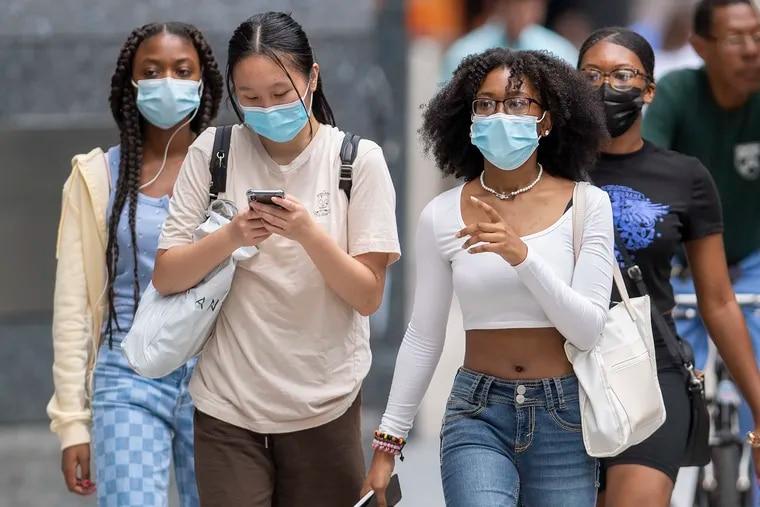 Pedestrians wear masks in Center City this week.