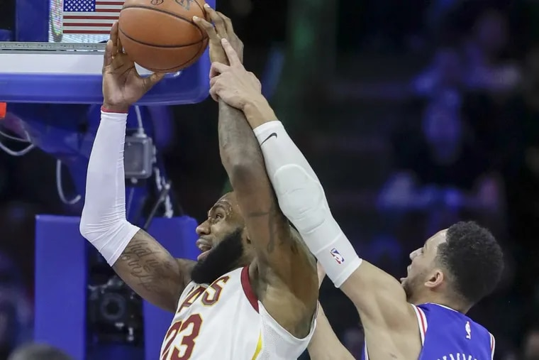 Ben Simmons fouls Cleveland forward LeBron James in the first quarter of the Sixers' 113-91 loss to the Cavaliers Monday night.