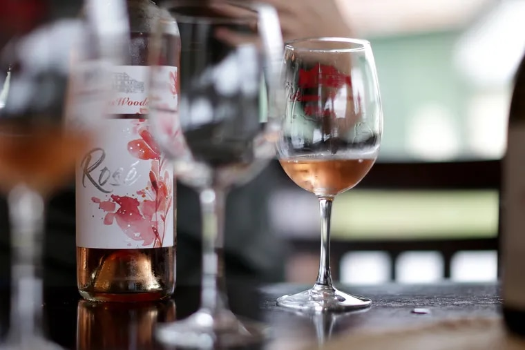 A bottle and glasses of the Penns Woods Winery Rose sit on a table during a tasting in Chadds Ford, PA on September 30, 2019.