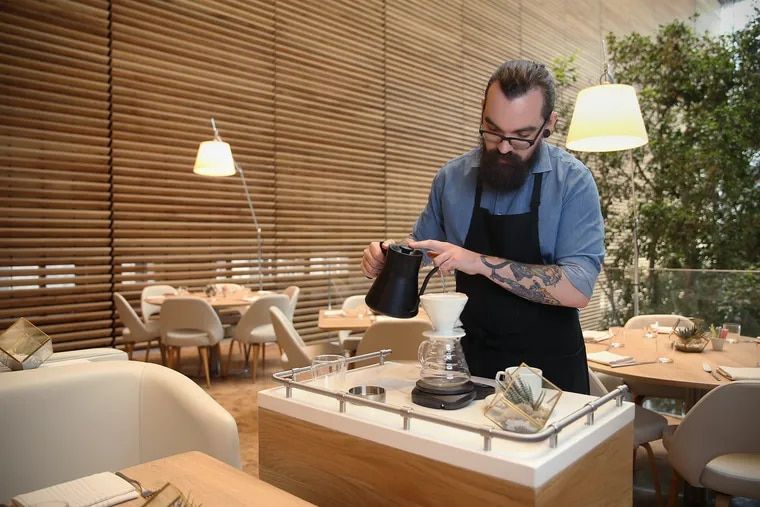 Barista Drew Chrisner demonstrates the tableside pour-over coffee at Vernick Coffee Bar inside the Comcast Technology Center.
