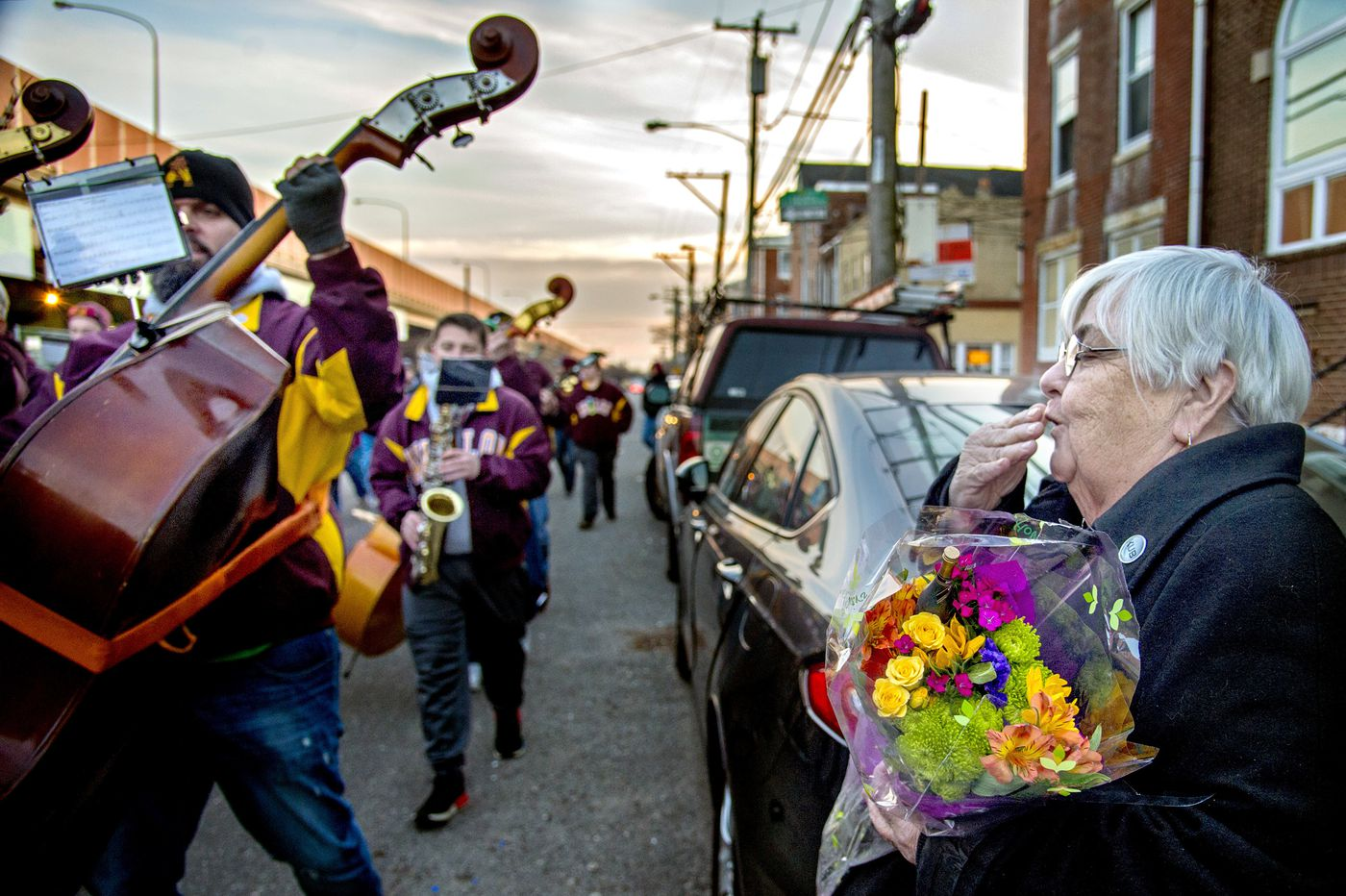 Mummers serenade mother of band member who died of suicide in 2012