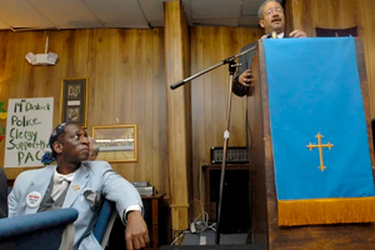 A patient man, White waits while U.S. Rep. Chaka Fattah states his case to a crowd at the Pentecostal Clergy PAC in East Germantown. Eventually, the moderator noticed White and gave him the floor.