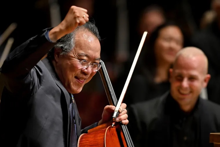 Cellist Yo-Yo Ma reacts with conductor Yannick Nezet-Seguin (right) onstage at Verizon Hall at the conclusion of his performance on opening night for the Philadelphia Orchestra at the Kimmel Center Oct. 5, 2021,