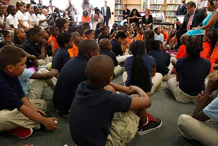 File photo: School children in Camden meet with Gov. Chris Christie, Mayor Dana Redd and the school district's new superintendent, Paymon Rouhanifard. The district showed flat or slightly improved student test scores last year.  (David Maialetti/Staff)