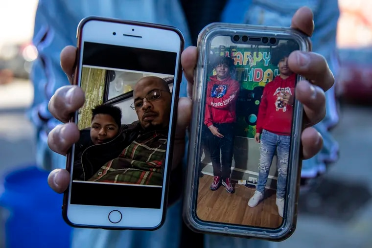A family member displays images of Jesus and Jeremy Perez (left). At right is Jeremy wth his cousin Giovanny Capulin, 17. Jesus Perez, 44, and his son Jeremy, 15, were shot and killed on Christmas morning in Kensington.