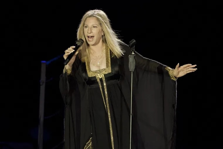 """Barbra Streisand performs during a 2103 concert in Tel Aviv, Israel.  On Nov. 22, Netflix will premiere her new concert special, """"Barbra:  The Music… The Mem'ries… The Magic!"""""""