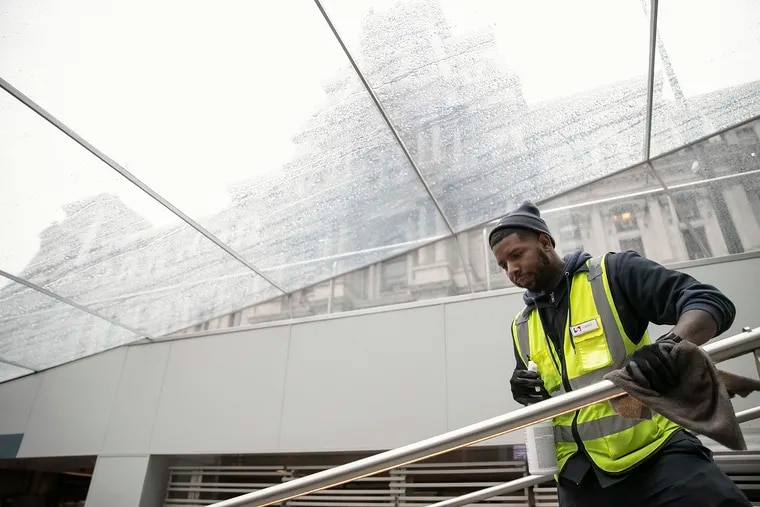 John Mathis, a SEPTA employee, disinfects the rails at the 15th street station on the Broad Street line on Friday, March 06, 2020. The cleaning is happening frequently for COVID-19 response.