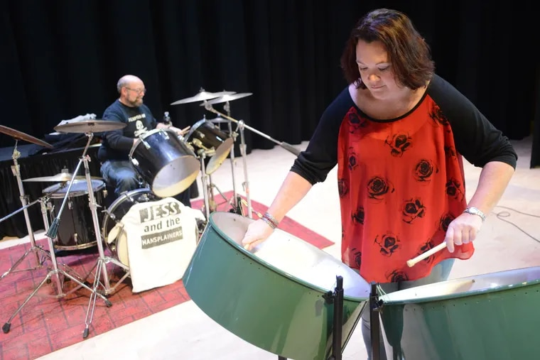 """Jess McCall, associate English professor at Delaware Valley University, plays the steel drums during rehearsal for the band """"Jess and the Mansplainers,"""" which she formed with three other faculty members."""