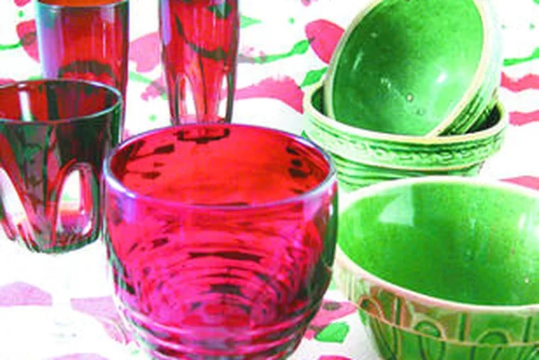 Vintage green-glazed stoneware is perfect for casual holiday parties along with red glasses and silk-screened Sixties fabric.