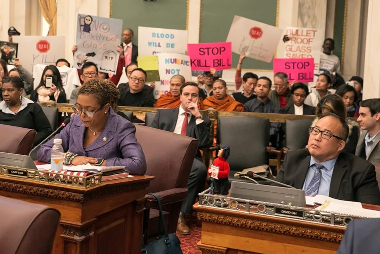 Councilwoman Cindy Bass, left, and Councilman David Oh shown here during a session of city council, at City Hall, much of the session focused on a controversial bill that would increase oversight on beer delis and Stop-N-Go shops, and could order the removal of bullet-resistant windows inside these businesses, Thursday, Dec. 14, 2017. JESSICA GRIFFIN / Staff Photographer