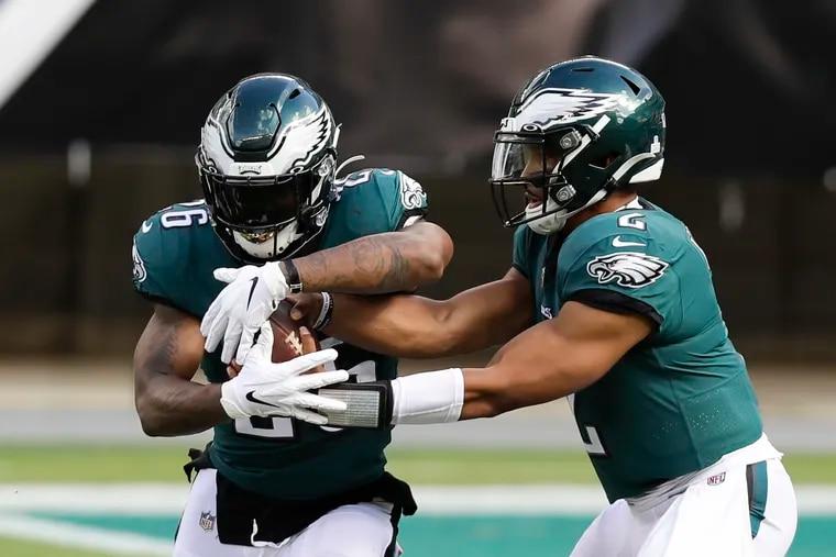 Eagles quarterback Jalen Hurts  handing off to Miles Sanders against the Baltimore Ravens last October.
