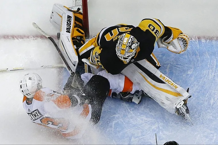 The Flyers' Jake Voracek collides with Penguins goalie Matt Murray in the second period Monday. Murray was injured on the play.