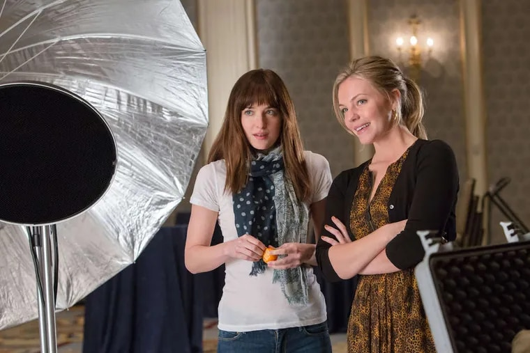 """In """"Fifty Shades of Grey,"""" Dakota Johnson (left) is a student in a bondage-dominance contract with a billionaire, and Eloise Mumford is her best friend."""