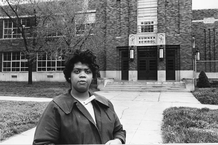Linda Brown Smith is shown in front of the Sumner School in Topeka, Kansas, in 1964. The refusal of the  school to admit Brown in 1951, when she was nine years old, because she was black, led to the Brown v. Board of Education of Topeka, Kansas. But this isn't the photo that spread around the world after her death.