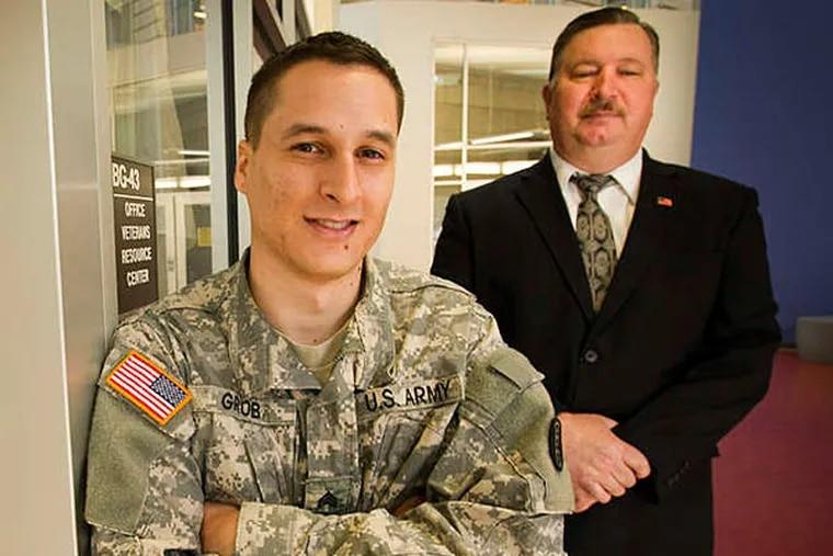 Eduardo Grob, an Army veteran from Brazil who graduated from Community College of Philadelphia on Saturday, with his mentor Steve Bachovin. ALEJANDRO A. ALVAREZ / STAFF PHOTOGRAPHER