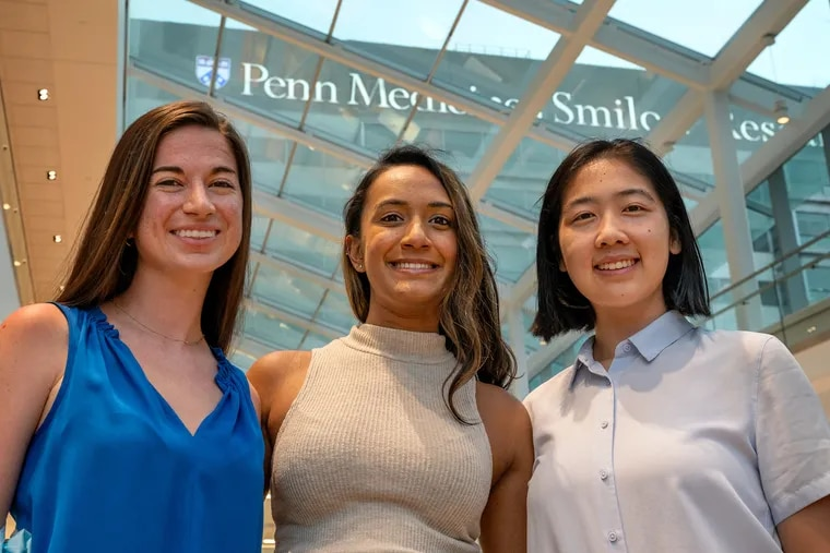 Three first-generation low-income (FGLI) medical students at the University of Pennsylvania have started a podcast called Med Legs to share their experiences and tips navigating medical school. The three podcast hosts Michaela Hitchner, (from left), Anitra Persaud and Cecilia Zhou pose Sept. 7, 2021 at the Perelman Center for Advanced Medicine.
