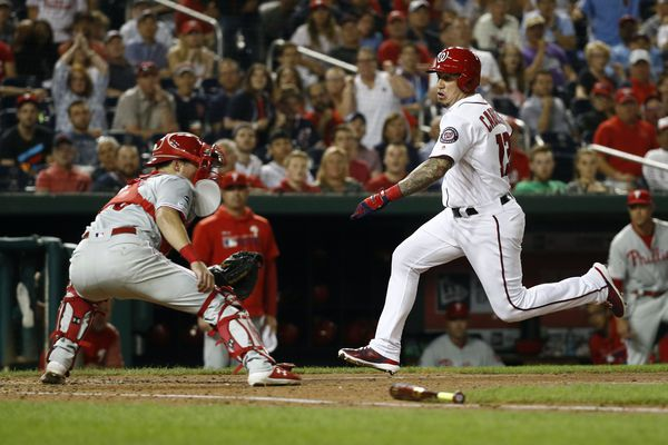 With owner John Middleton watching, Phillies lose fifth straight, fall to .500, as Bryce Harper objects to verbal barbs from Nationals' fans