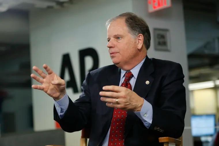 Sen. Doug Jones, D-Ala., speaks during an interview at the Associated Press in Washington, Wednesday, Dec. 12, 2018. (AP Photo/Pablo Martinez Monsivais)
