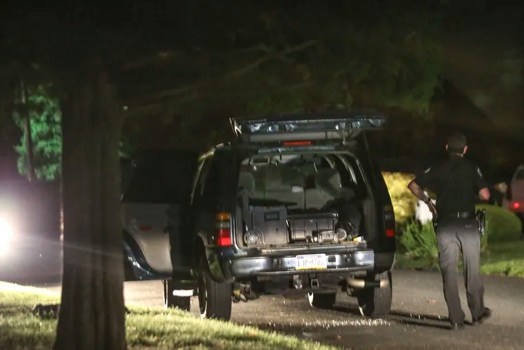 Police hold the scene after a man wanted for an attempted homicide in Delaware County allegedly shot at police in Southwest Philadelphia and stole an unmarked police SUV, then abandoned the vehicle here in Deptford, N.J., Monday, August 23, 2021.