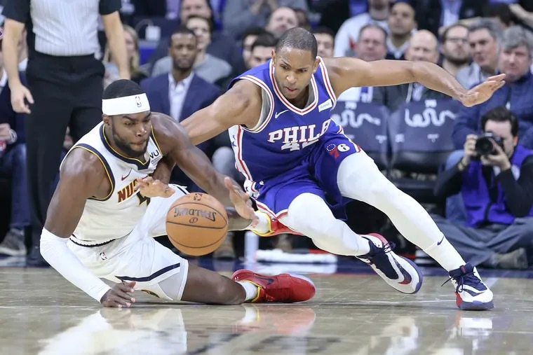 Sixers' Al Horford, diving for a loose ball with Denver's Nuggets' Paul Millsap on Dec. 10, looked out of sync in Sunday's loss in Brooklyn. Horford had been sidelined the previous two games with a sore knee and hamstring.