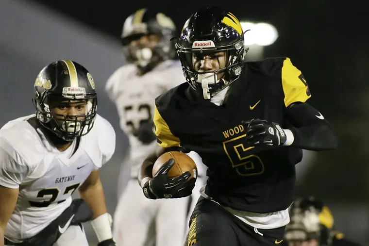 Archbishop Wood's Nasir Peoples, here scoring in the state final, is a member of the Daily News first team.