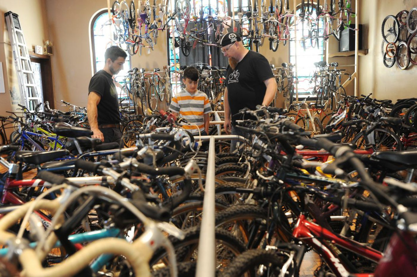 From bike shop to drive-thru prayer, churches try thinking outside the pew