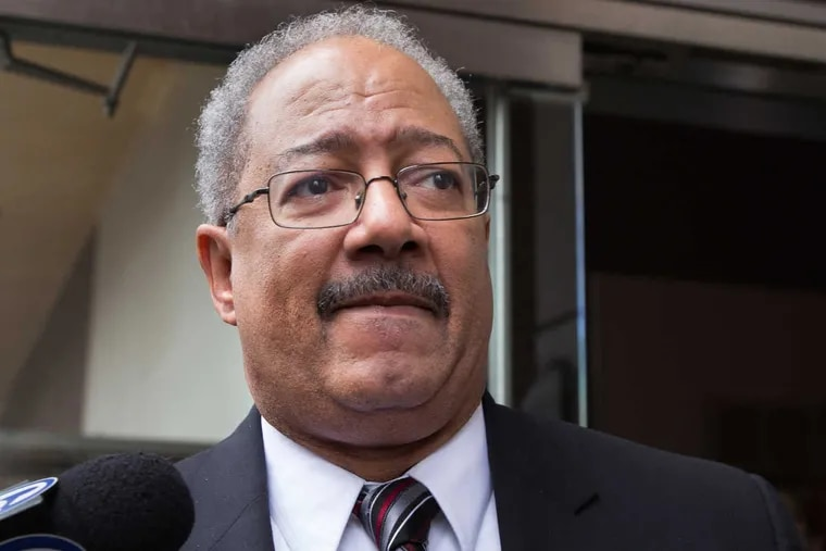 Former U.S. Rep. Chaka Fattah exits federal court after being sentenced to 10 years in prison Monday.