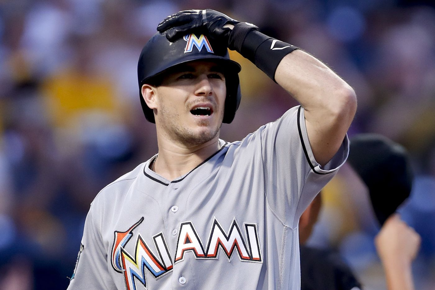 Catcher J.T. Realmuto traded from Marlins to Phillies for three players