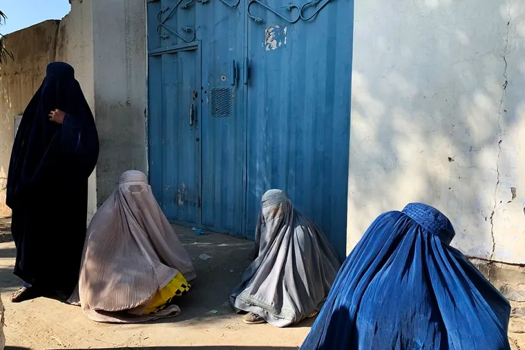 Women who fled clashes between the Taliban and government forces wait outside a government office in central Kandahar city hoping to collect aid for civilians displaced by the conflict. Afghan government figures say between 6,000 and 7,000 civilians have been displaced by fighting in Kandahar.