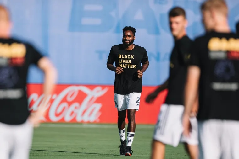 Union midfielder Warren Creavalle, center, designed the Black Lives Matter t-shirts worn by coaches and players across Major League Soccer.