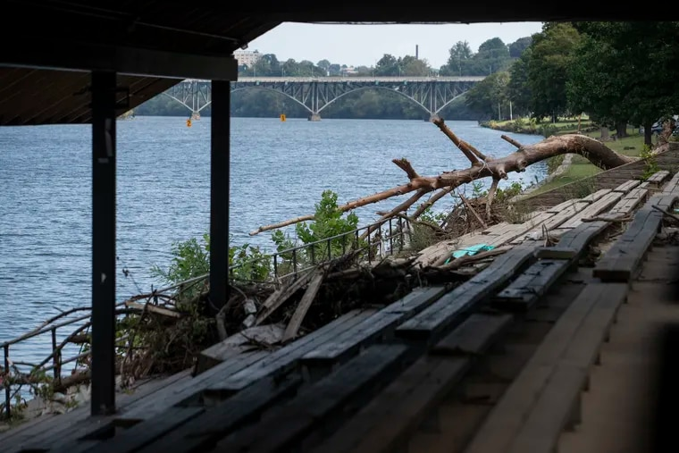 Debris remains in the bandstand along the Schuylkill River Trail near the Columbia Train Bridge in Philadelphia on Wednesday. More rains are due, but the Schuylkill is forecast to behave.